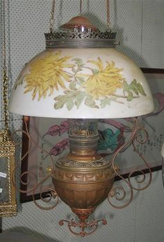 A 19th century Miller ?Empress? hanging lamp, brass font, hand painted opal glass shade with yellow flowers