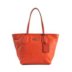 Coach Taxi Zip Tote.  I ordered this babe online and she came beautifully presented in a massive gift box.  Shame that she does not have feet to protect her bottom, but such a perfect shape and size for tootling around.  The orange colour also goes with almost everything in my wardrobe.  Bag was somewhere shy of 145 pounds and was half price.  Bargain.