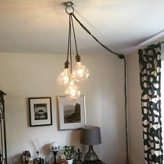 3 Custom Plugin Pendant Lights Hanging from a ring.