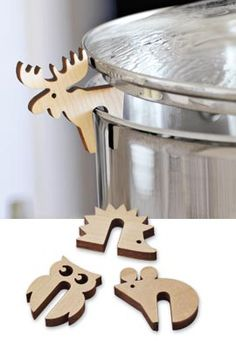 www.stainlesssteeltile.com likes this idea! ❧ Little Pot Guard critters prevent overflows....would make great stocking stuffers!