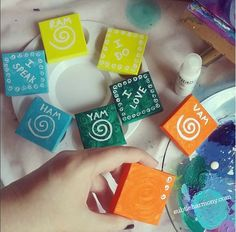 Chakra energy! I'm working on more 'chakra minis' for my Etsy shop. Hand-painted mini-canvases in the color associated with the chakra, and the mantras and seed sounds for each chakra.