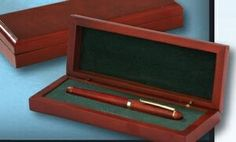 This Beautiful Rosewood Single Pen in a gift box lined with green felt. will be a a great gift for any executive or retiree. You can personalize the top of the wood box with a message or logo.