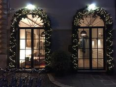 Honestly, if we could, we would keep this entrance, beautifully decorated and illuminated, all year long!  we just love it!  #thefifteenkeyshotel #fifteenkeys #feelshomey #rionemonti #Rome #roma #italy #entrance #facade #lights #xmaslights #christmaslights