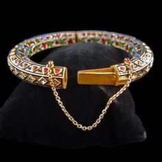 A Mughal Gold, Diamond, Ruby and Enamel Bangle
