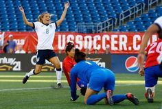 Kristie Mewis celebrates after beating South Korea goalkeeper Kim Jungmi. (Jared Wickerham/Getty Images)