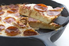 Cheesy delicious low carb pizza baked in a skillet. Keto LCHF Banting THM recipe.