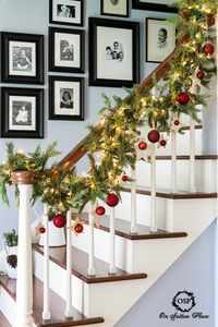 DIY Christmas Stairway Garland with white lights, stars and red balls. Inexpensive Christmas stairway decor.