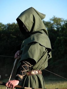 Robin hood, Yeoman. Green hood, cloak, and arrows. Representative of lower class chaucer finds the yeoman respectable.