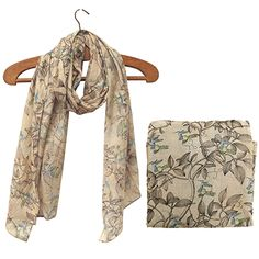 This Khaki, Lightweight cotton scarf forms part of the Aviary range from Disaster Designs. With its hand printed hummingbird pattern in hues of blues and turquoise this scarf makes the perfect addition to any outfit. - £8.95