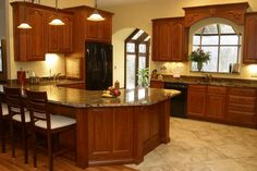 Tile backsplash cherry cabinets