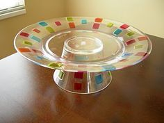 cake stand for Dollar Store finds, this one is really cute if the colors were right! Or maybe even use clear plate/cup and paint on glittery polka dots or something