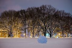 7-10 ft snowballs put together by some landscape architecture students become colorful works of art on Cook Campus