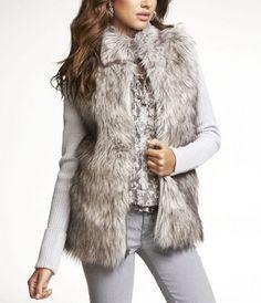 i don't know what it is but love the look of a fur vest