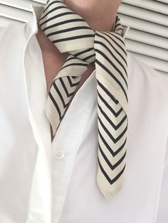 <p>  The San Remo Scarf is crafted from light-nude silk-faille with signature monogram pattern in dark navy. Style it as a neckerchief, or knot it around any handle for a chic and instant update of your look.</p>