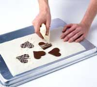how to make chocolate hearts (or any shape) for decorations on puddings, cakes, cookies, etc.