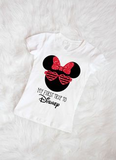Always FREE U.S. shipping! My First Trip to Disney custom graphic tee shirt with Minnie Mouse glitter detail. Perfect for that first special trip! Also available in a onesie or adult sizes... just send us a message!  ****Listing is for the shirt ONLY!****  Every item is made to order and can be customized. If you see another color or design you like, just ask, and we can make it happen for you!   Gemma tees are wash and wear - No dry cleaning! - Wash and dry inside out! - For best care lay…