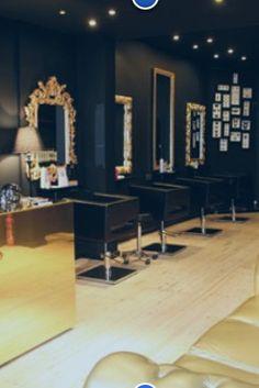 Hair salon. Black walls. Gold mirrors. Black modern chairs. This is a good…