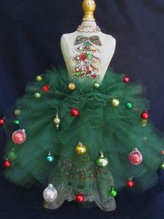 Traditional Christmas colors with vintage jewelry and ornaments on a dress form