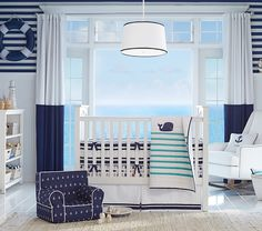 Nursery bedding inspired by stripes and the blue sea :)