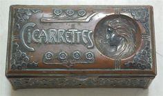 A French Art Nouveau pierced copper table cigarette box