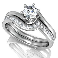 D34089 - Alba Rose Round diamond solitaire engagement ring and matching shaped diamond wedding ring