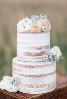 Rustic Naked White Wedding Cake Topped Flowers | Brides.com