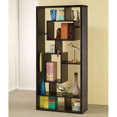 This+wall+unit+can+be+used+to+dress+up+any+wall+with+the+look+of+interlocking+shelves,+which+provide+storage+and+display+space+in+different+sized+compartments.+Finished+in+cappuccino.