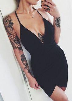 wrap black mini dress. #tattoos