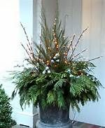 Simple Outdoor Christmas Decorating - Bing Images how will this look with a sap bucket?