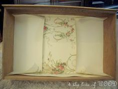 DIY:  How to Line a Drawer With Wallpaper - tutorial shows how to fold the paper to line drawers.