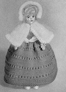 Link to download FREE knitting pattern for Cape and Hood Doll knit pattern published in Dolls, Doreen Knitting #104.