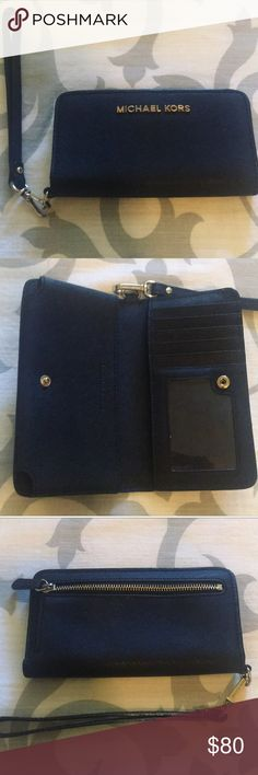 Michael Kors Jet Set Slim Tech Wristlet (black) Only worn a few times!!! Great condition!!! Has a place for your cell phone and your cards and license! This wristlet is great for any occasion! Really great for concerts! Can't be bundled! Michael Kors Bags Clutches & Wristlets