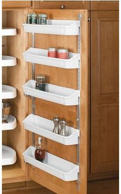 Simplify Your Organization: Hold your spices in places on a shelf mounted on the inside of your cabinet door. Good for RVs or your kitchen. #UniversalTrim