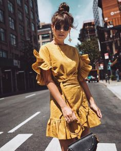 $74 Storets The Dream Dark Yellow Statement Dress Short Sleeved Ruffle Sleeved Wrap Around Ruffle Bottom Mini Dress Teamed With Retro Round Ray-Ban Sunglasses And Statement Dangle Earrings Tumblr