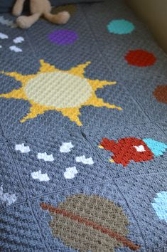 FREE Crochet Pattern: C2C Solar System Blanket | Learn how to work the Corner to Corner technique while making this pretty outer-space themed blanket!