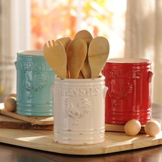 There's nothing more country than roosters and distressed colors! Keep your kitchen organized with our aqua, ivory, red, green, cobalt or white Vintage Rooster Utensil Holders.