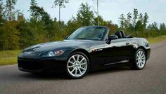 2004 Honda S2000 AP2. Berlina Black exterior with red/black leather interior.  What a blast this car was to drive.  6spd, RWD, 200HP+, lightweight... I'm not typically a convertible guy but this car has the goods!  Very much a drivers car.