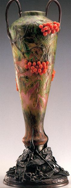 DAUM .   Vase in molten glass with applications of leaves and flowers , wrought iron base, acid and working at the mill, 1902.    H. 60 cm. Kitazawa Museum  of Art.