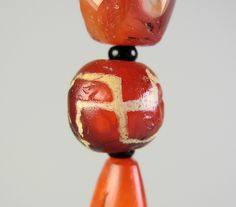 Ancient carnelian displaying the sacred swastika decoration. Swastika is an ancient sanskrit word (Sanskrit: स्वस्तिक) that means auspicious or well being.  Some of the earliest forms of the swastika come from the Indus Valley civilisation (3300–1300 BCE). In the Yungdrung Bön tradition of Tibet, the swastika is considered to be an ancient symbol of indestructibility and represents the very essence of the wisdom of Bön.  Asacred symbol in Buddhism, Hinduism and Jainism.  dZi bead blogspot~
