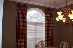 Drapes over arched window