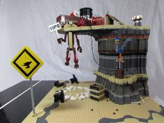 This is the clever Road Runner and Wile E. Coyoto LEGO scene built by LEGO Moc user matt rowntRee. I like everything about it. And, as you can see, Wile E. Coyote has bitten off more than he can...