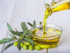Bottle Pouring Virgin Extra Olive Oil Stock Photo (Edit Now) 328572848 Organic Face Products, Pure Products, Beauty Products, Best Body Scrub, Dark Circle Remedies, Cancer Causing Foods, Dark Circles Under Eyes, Fatty Liver, Homemade Face Masks