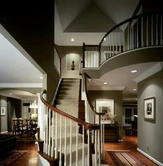 ♥ Amazing house layout.  Love the angles, the curved balcony railing and stairs, the green / gray wall colors, the recessed lights, the vaulted ceiling portion at the top of the stairs.  Elegant, yet very comfortable.  Picture from a blog that is no longer there.  No more picture information available.