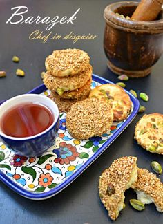 Pistachio honey sesame cookies (aka barazek)   Makes 30 cookies: 1 cup (200 g) butter softened 1 and 1/4 cups confectionary sugar 2 eggs 2 teaspoons vanilla 2 teaspoons vinegar 3 cups flour 1 teaspoon baking powder Pinch of salt 1 cup pistachio roughly chopped 1 cup sesame seeds 3 tablespoons honey or simple syrup