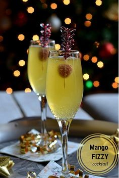 Mango Fizzy Cocktail - A tropical flavored cocktail with mango vodka and sparkling cider to serve for your New Years Party! http://www.cookingcurries.com