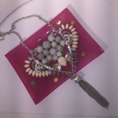 Stunning statement necklace from Macy's Absolutely stunning statement necklace with pink, lavender, gray cracked stone feature stones with silver peach and white beads. Macy's Jewelry Necklaces