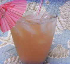1 ounce coconut rum (Malibu)  1 ounce peach schnapps (Dekyuper)  1 ounce vodka (Skky)  2 ounces pineapple juice  2 ounces cranberry juice  1 orange wedge (optional)  Ice