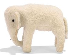 A STEIFF WOOL PLUSH STANDING ELEPHANT, (1514,0), white, black boot button eyes, felt tusks, velvet ear-linings, squeaker and FF button, circa 1912 --6½in. (16.5cm.) long (very minor wear)
