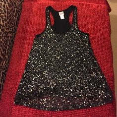 Sequin tank Black racer back tank with sequins on front only. I'll sequins intact with none missing. Victoria's Secret Tops Blouses