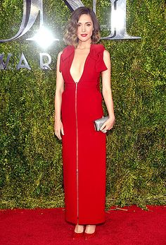 Radiant in red! Spy beauty Rose Byrne modeled a cherry-hued Delpozo dress with bow-topped shoulders, a zip-up front, and a deep V-neckline. A shimmering Oroton clutch and suede Brain Atwood heels completed her ensemble.